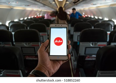KUALA LUMPUR, MALAYSIA - NOVEMBER 19, 2016: A traveler hold a smart phone with Airasia mobile app.The app helps managing travel plans, make bookings, check-in and choose seat anytime, anywhere.