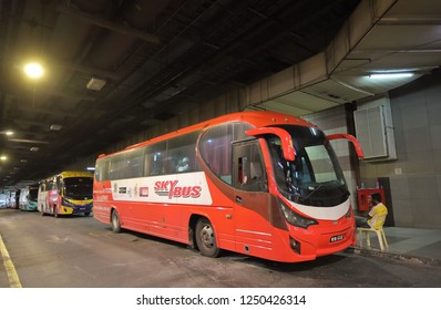 KUALA LUMPUR MALAYSIA - NOVEMBER 20, 2018: Unidentified people travel by airport shuttle bus in Kuala Lumpur Malaysia