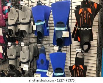 Kuala Lumpur, Malaysia - November 2018 : Decathlon sporting goods and outdoors store in Damansara Utama. Swim fins of sale in Decathlon market. Damansara, Malaysia.