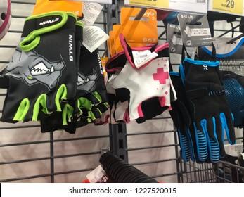 Kuala Lumpur, Malaysia - November 2018 : Decathlon sporting goods and outdoors store in Damansara Utama. Gloves of sale in Decathlon market. Damansara, Malaysia.