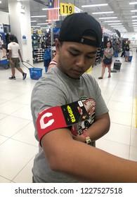 Kuala Lumpur, Malaysia - November 2018 : Decathlon sporting goods and outdoors store in Damansara Utama. Caption football arm of sale in Decathlon market. Damansara, Malaysia.