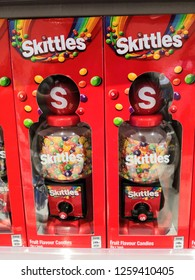 Kuala Lumpur, Malaysia - November 2018: Pack of Skittles candy display for sale in supermarket.Skittles is a brand of fruit-flavoured candy, currently produced and marketed by the Wrigley.