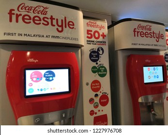 Kuala Lumpur, Malaysia - November 2018:Beverage vending machines selling Coca-Cola products at the shopping mall. Coca Cola is headquartered in Atlanta.
