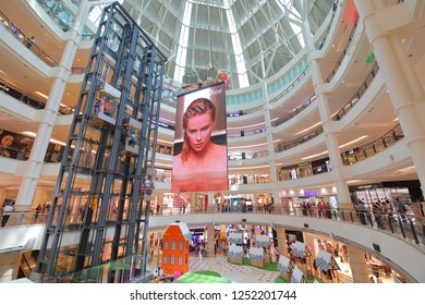KUALA LUMPUR MALAYSIA - NOVEMBER 21, 2018: Unidentified people visit Suria KLCC Shopping mall in Kuala Lumpur Malaysia