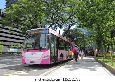 KUALA LUMPUR MALAYSIA - NOVEMBER 22, 2018: Unidentified people travel by GOKL bus in Kuala Lumpur Malaysia
