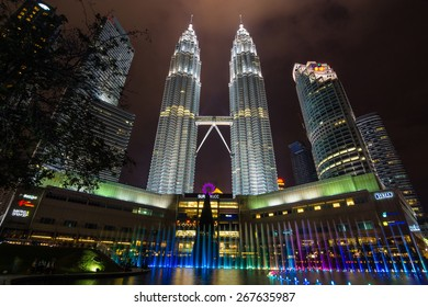 Kuala Lumpur, Malaysia - November 22 2014: The Petronas twin towers shine at night with fountain show in the Kuala Lumpur City Center (KLCC). The image was taken a month before the Christmas Day.