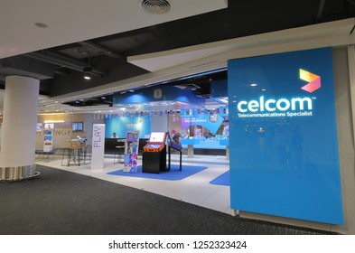 KUALA LUMPUR MALAYSIA - NOVEMBER 23, 2018: Unidentified people work at Celcom shop at KLIA airport in Kuala Lumpur Malaysia. Celcom is the oldest mobile telecommunication company in Malaysia.