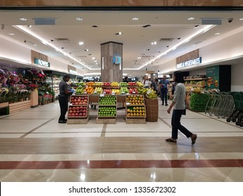 Kuala Lumpur, Malaysia. November 23, 2018.Patron walking across the entrance of Cold Storage Supermarket at Suria Mall KLCC, one of the anchor tenant serving groceries to the citizen and tourists.