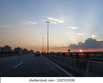 Kuala Lumpur, Malaysia. November 23, 2018. Driver's perspective while driving during sunset along Maju Expressway or MEX, one of the major expressway on Kelang Valley connecting Cyberjaya