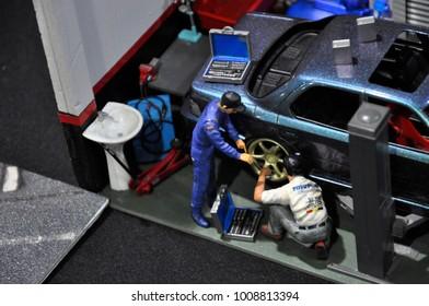KUALA LUMPUR, MALAYSIA -NOVEMBER 26, 2017: Miniature scale of car workshop. The mechanic busy repairing cars.