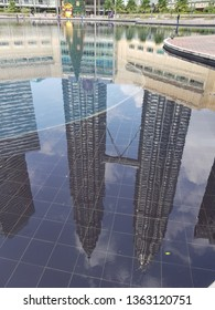 Kuala Lumpur, Malaysia. November 26, 2018. The reflection of tallest Christmas Tree replica in Malaysia was on display in front of Symphony Lake Esplanade KLCC in the celebration of Christmas Day