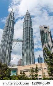 Kuala Lumpur, Malaysia  - November 27 2014: Petronas Twin Towers and Suria KLCC, seen from park side