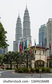 "Kuala Lumpur, Malaysia  - November 27 2014: Kuala Lumpur, Malaysia: Malaysia Tourism Centre (MaTiC), aka ""Pusat Pelancongan Malaysia"" in front of Petronas Twin Towers and Suria KLCC"