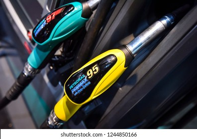 KUALA LUMPUR, MALAYSIA - NOVEMBER 28, 2018 : Closeup new yellow nozzle for Petronas Primax 95 & green nozzle for Primax 97 at Petronas petrol station. Petronas is a Malaysian oil and gas company.