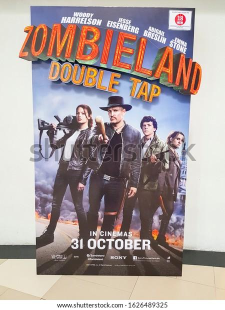 KUALA LUMPUR, MALAYSIA - NOVEMBER 6, 2019: Zombieland: Double Tap movie standee, the movie starring Woody Harrelson, Jesse Eisenberg and Emma Stone