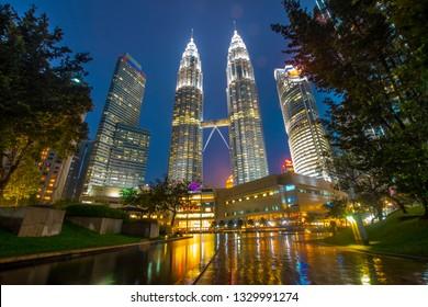 KUALA LUMPUR, MALAYSIA : November 7 2018 - View Kuala Lumpur city urban downtown skyline of Malaysia, beautiful cityscape wallpaper in Sunset moment and Night Moment. Twin Tower Malaysia Icon