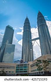 KUALA LUMPUR, MALAYSIA - NOVEMBER 7: View on famous high-rise Petronas twin tower with bridge, Kuala Lumpur. November 2015