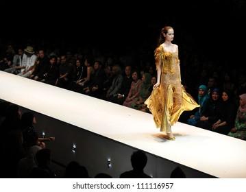 KUALA LUMPUR, MALAYSIA - NOVEMBER 8: Model presents creation by Amir Luqman during Malaysia-International Fashion Week on November 8, 2009 in Kuala Lumpur, Malaysia.