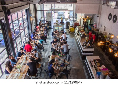 Kuala Lumpur, Malaysia Oct 02 2016 - modern cafe with cozy industrial concept is a trend for the youngster, a coffee culture to hang around with friends, high angle view of a busy restaurant