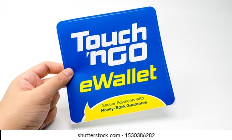 Kuala Lumpur, MALAYSIA - Oct 2, 2019:  Holding Touch 'n Go or TnG eWallet sticker. Touch 'n Go eWallet is an integrated mobile app to use the physical Touch 'n Go Card in Malaysia.