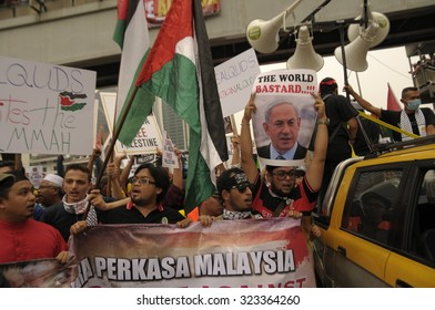 "KUALA LUMPUR, MALAYSIA - OCT 2: Protestant holding picture of Benjamin Netanyahu reading ""The World Bastard"" during peaceful rally outside of US embassy in Kuala Lumpur, Malaysia on October 2, 2015."