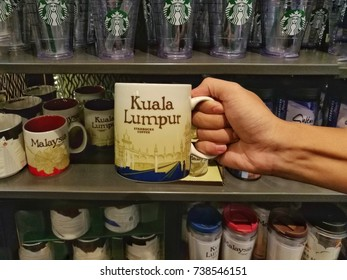 Kuala Lumpur, Malaysia - Oct 20, 2017: Starbucks City Mugs representing locations in the Malaysia. There are collectible souvenir coffee mugs available in Starbucks stores throughout the world.