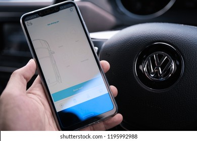 KUALA LUMPUR, MALAYSIA - OCT 6TH, 2018: modern lifestyle with smartphone to stay connected and browsing favourite Apps. Let you book one way ride or another with Car Sharing Platform SOCAR