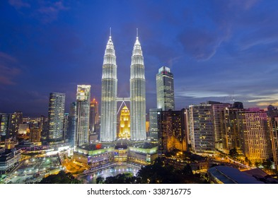 KUALA LUMPUR, MALAYSIA - OCT19: Petronas Twin Towers at twilight on Oct 19, 2015 in Kuala Lumpur. Petronas Twin Towers are twin skyscrapers and were tallest buildings in the world from 1998 to 2004.