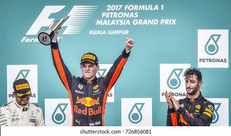 KUALA LUMPUR, MALAYSIA - OCTOBER 01, 2017 : Race winner Max Verstappen  celebrates with Lewis Hamilton and Daniel Ricciardo celebrate on the podium during Malaysia Grand Prix at Sepang Circuit.