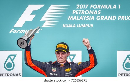 KUALA LUMPUR, MALAYSIA - OCTOBER 01, 2017 : Race winner Max Verstappen of Red Bull Racing celebrates on the podium during Malaysia Grand Prix at Sepang International Circuit.