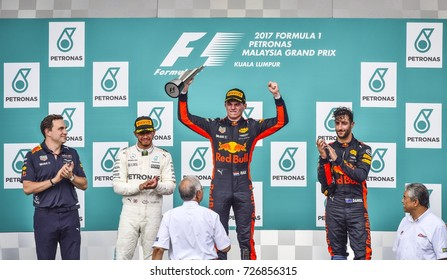 KUALA LUMPUR, MALAYSIA - OCTOBER 01, 2017 : Race winner Max Verstappen  celebrates with Lewis Hamilton and Daniel Ricciardo celebrate on the podium during Malaysia Grand Prix at Sepang Circuit.