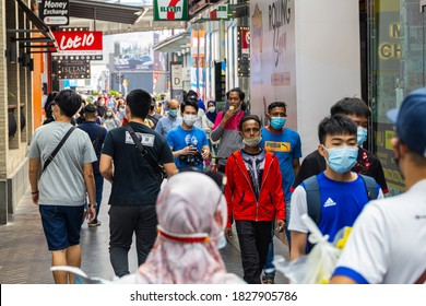 Kuala Lumpur, Malaysia - October 04, 2020: The Bintang walk downtown of Kuala Lumpur. People with Face mask passing by. Face masks are compulsory in crowded areas in Malaysia. Change of the cityscape