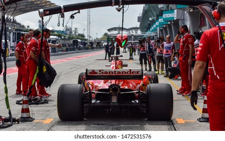 KUALA LUMPUR, MALAYSIA - OCTOBER 1, 2017 : Sebastian Vettel (Germany) making a pitstop in the Scuderia Ferrari SF71H F1 2018 car during the F1 at Sepang Circuit.
