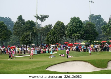 KUALA LUMPUR, MALAYSIA - OCTOBER 10, 2015: Golf fans watch the action on the 9th hole green of the KL Golf & Country Club on Round 3 day at the 2015 Sime Darby LPGA Malaysia golf tournament.