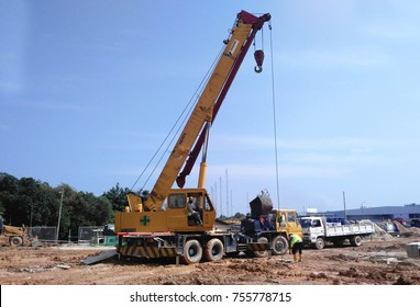 KUALA LUMPUR, MALAYSIA -OCTOBER 11, 2016: Mobile crane is the heavy machine used to lifting heavy material at construction site. Material was hang using strong and heavy duty cable.