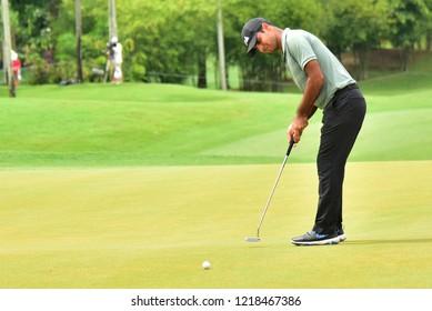 KUALA LUMPUR, MALAYSIA - October 13: Shubhankar Sharma of India, play his putt at 18th green, during round three of CIMB CLASSIC 2018 at TPC Kuala Lumpur, KUALA LUMPUR, MALAYSIA on October 13, 2018.