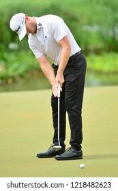 KUALA LUMPUR, MALAYSIA - October 13: Bronson Burgoon of United States make a putt at 5th green, during round three of CIMB CLASSIC 2018 at TPC Kuala Lumpur, KUALA LUMPUR, MALAYSIA on October 13, 2018.