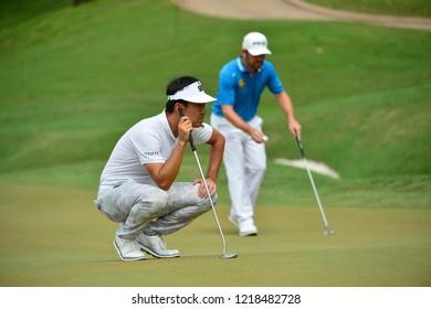 KUALA LUMPUR, MALAYSIA - October 13: Kevin Na of USA(L) check the line before make a putt, during round three of CIMB CLASSIC 2018 at TPC Kuala Lumpur, KUALA LUMPUR, MALAYSIA on October 13, 2018.