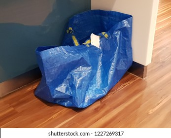 Kuala Lumpur, Malaysia. October 15, 2018. The famous IKEA - FRAKTA Carrier bag laying on the floor under the table top island at an office
