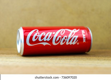 KUALA LUMPUR, MALAYSIA - OCTOBER 15, 2017 : Aluminium can of Coca cola Klasik/Classic soft drink on wooden background.The Coca-Cola Company, an American multinational beverage corporation.