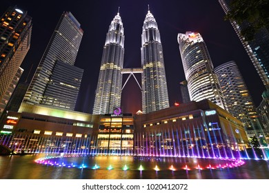 Kuala Lumpur, Malaysia : October 17, 2017 - Beautiful colorful musical fountain at night with background of Petronas Twin Tower and Suria KLCC. Petronas Twin Tower is the tallest building in Malaysia