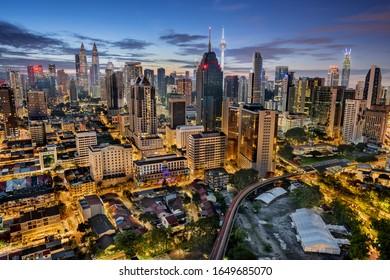 Kuala Lumpur, Malaysia - October 23, 2019: Kuala Lumpur skyline with Petronas Twin Towers and Menara Tower taken from above at sunrise
