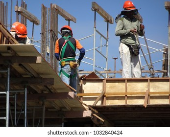 KUALA LUMPUR, MALAYSIA -OCTOBER 24, 2017: Construction workers fabricated timber form work at the construction site. Form work made from plywood and timber become mold for concrete.