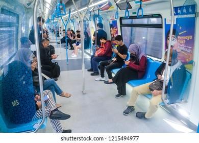 KUALA LUMPUR, MALAYSIA : OCTOBER 25, 2018 : Passenger inside Malaysia Mass Rapid Transit (MRT) train. People commute with MRT as transportation to work, school, travel and shopping.