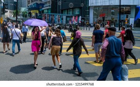 KUALA LUMPUR, MALAYSIA : OCTOBER 25, 2018 : People crossing road at MRT (Mass Rapid Transit) Bukit Bintang station. Bukit Bintang is a tourist attraction place for shopping, eat and sightseeing.