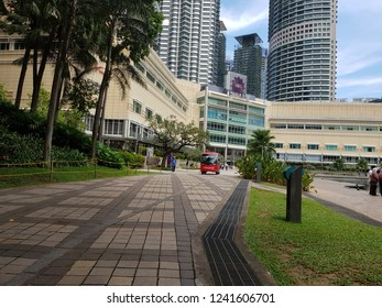 Kuala Lumpur, Malaysia. October 26, 2018. Pedestrian walk corridor at KLCC Park near KL Convention Centre also being used by electric buggy provided by Trader Hotel and The Binjai to Suria Mall