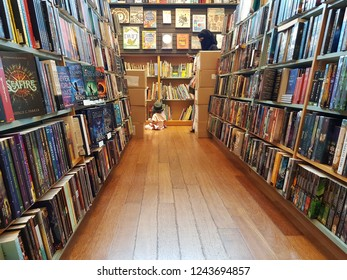 Kuala Lumpur, Malaysia. October 26, 2018. Rows of books on display shelves at Kinokuniya Bookstore KLCC, Malaysia largest bookstore offering books, magazines, music, CD, Manga and much more.