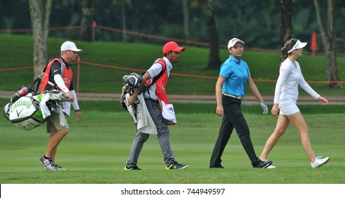 KUALA LUMPUR, MALAYSIA - OCTOBER 27, 2017 : Winnie Ng ( two right) of Malaysia and Sandra Gal (right), of Germany  in action  the 2017 Sime Darby LPGA Malaysia at TPC Kuala Lumpur East Course.