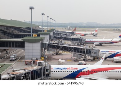 Kuala Lumpur, Malaysia â?? October 27th 2016: Several Malaysian Airlines aircraft on gates, viewed from the Business Lounge at the International Terminal, KLIA.