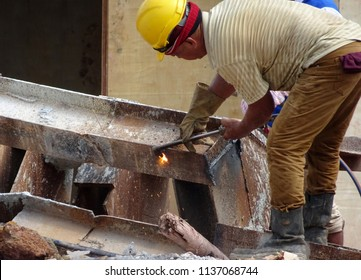 KUALA LUMPUR, MALAYSIA -OCTOBER 28, 2017: Construction workers cutting steel I beam using blowtorch at construction site. Blowtorch produced very high temperature flame that able to cut metal.